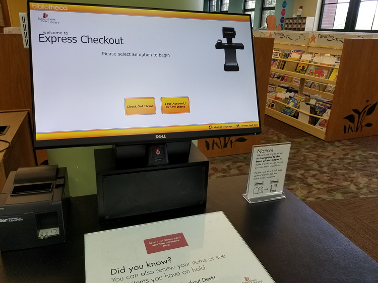 An express checkout station with computer screen, tabletop, and receipt printer.